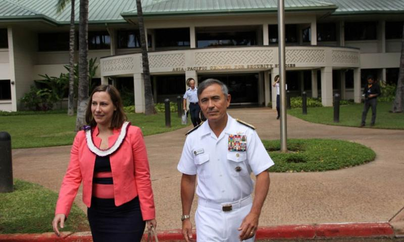 U.S. Pacific Command commander Harry B. Harris Jr., walks with Kelly Magsamen, principal deputy assistant secretary of defense for Asian and Pacific Security Affairs, outside the Daniel K. Inouye Asia-Pacific Center for Security Studies after the institution's 20-year anniverary ceremony Tuesday in Honolulu.    Wyatt Olson/Stars and Stripes