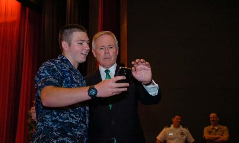 Ray Mabus, secretary of the Navy, takes a 'selfie' photograph with a sailor after an all-hands meeting at Yokosuka Naval Base's Fleet Theater on July 28, 2014. ERIC GUZMAN/STARS AND STRIPES