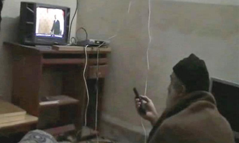 This undated image from video seized from the walled compound of al-Qaida leader Osama bin Laden in Abbottabad, Pakistan, and released by the Defense Department shows a man identified by the U.S. government as bin Laden in front of a television. DEPARTMENT OF DEFENSE