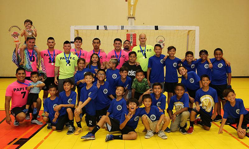 Papi FC was awarded the 2017 Budweiser Futsal League trophy after defeating Quality Distributors 12-4 in the league's championship match played Sunday at the Guam Sports Complex Gym. Papi FC team members in the photo, in pink or yellow, are: Ian Mariano (No. 7, front row), Jason Cunliffe, Ashton Surber, Joshua Alerta, Eddie Lee Lorenzo, Marcus Lopez, Jonahan Romero, Roy Abril, and David Drews.