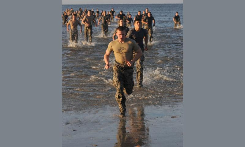Combat control trainees from the 334th Training Squadron run back on shore after doing 100 jumping jacks in the Gulf of Mexico during a physical training session April 12, 2013, on Biloxi Beach in Biloxi, Miss.   Kemberly Groue/U.S. Air Force