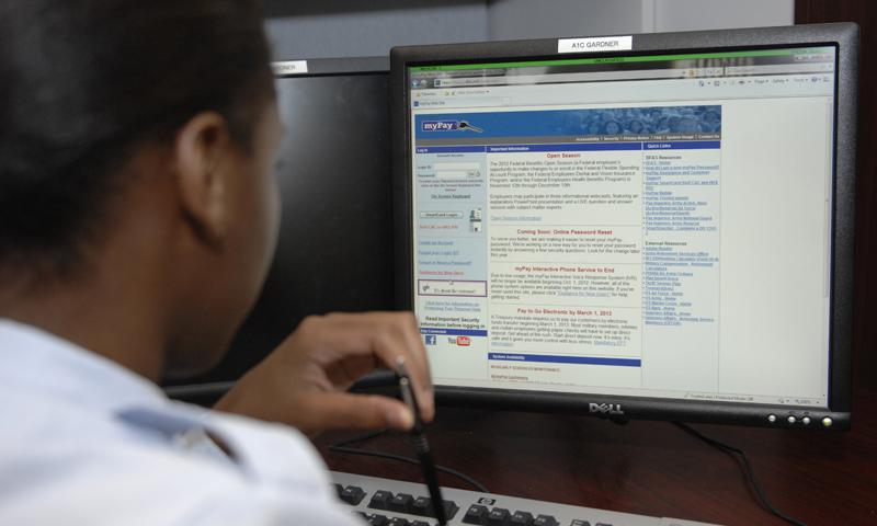 An airman logs into myPay to check her leave and earnings statement for her paycheck at Shaw Air Force Base, S.C. Krystal Jeffers/U.S. Air Force