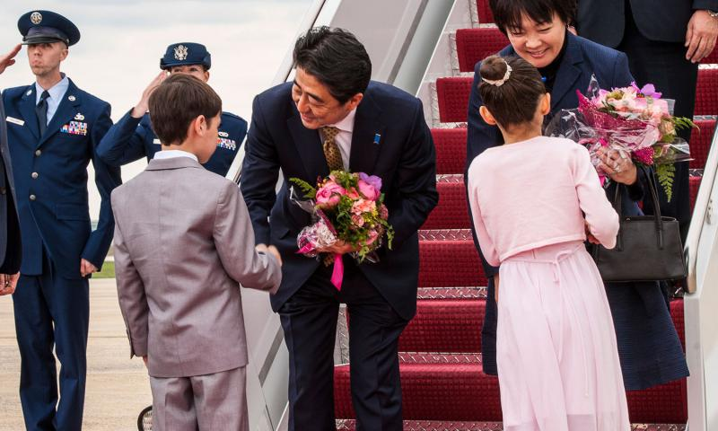 Japanese Prime Minister Shinzo Abe and his wife Akie Abe are greeted at Joint Base Andrews in Maryland on April 27, 2015. 	 Kevin Wallace/U.S. Air Force