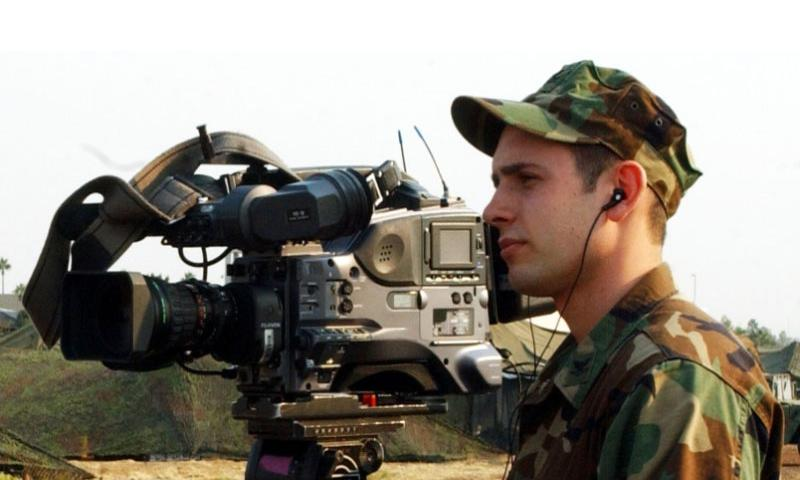 Navy Petty Officer 2nd Class Andrew Krauss with the then-Pentagon Channel films an interview at the Montgomery Airfield in San Diego, Calif., in October, 2007.  U.S. Army