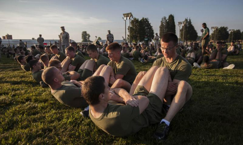 Officer Candidate School candidates undergo the physical fitness test at Marine Corps Base Quantico, Va., June 1, 2016. Changes for the physical and combat fitness tests are slated to take effect Jan. 1, 2017, while tweaks to the body composition program are already in place. 	 Laura Mercado/U.S. Marine Corps