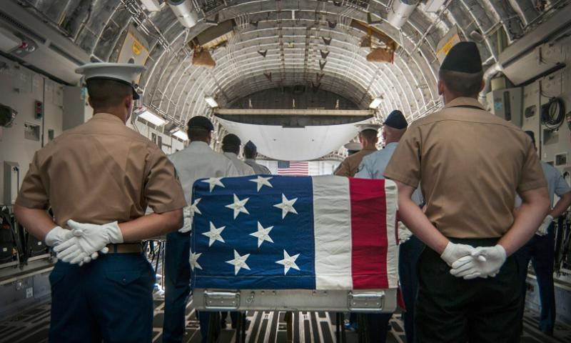 An honor detail comprised of joint military members prepares to escort the remains of fallen servicemembers who died during World War II and the Vietnam War during an arrival ceremony April 26, 2013, hosted by the U.S. Joint POW/MIA Accounting Command. SEAN FUREY/U.S. NAVY