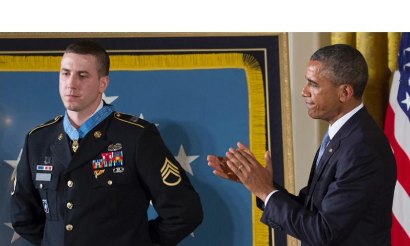 President Barack Obama leads the applause after awarding former Army Staff Sgt. Ryan Pitts the Medal of Honor at the White House, July 21, 2014. Joe Gromelski/Stars and Stripes
