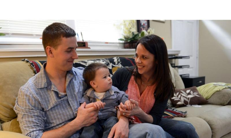 Pictured in April at their home in Nashua, N.H., are Ryan Pitts, Amy Pitts, and 1-year-old son Lucas. COURTESY OF THE U.S. ARMY