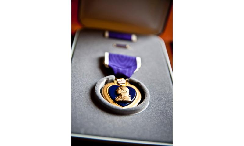 A Purple Heart Medal. The Purple Heart is one of the oldest commendations in American military history, dating back to the later years of the Revolutionary War and was originally designed as the Badge of Military Merit. TIMOTHY KOSTER/U.S. ARMY