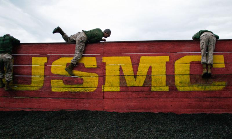 Recruits climb over a wall during the obstacle course Feb. 25, 2013 on Parris Island. David Bessely/U.S. Marine Corps
