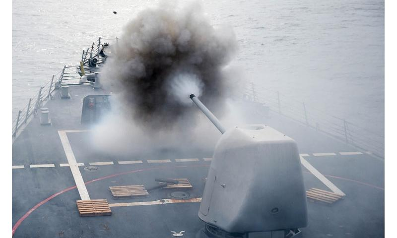 An MK 45 5-inch lightweight gun is fired from the Arleigh Burke-class guided missile-destroyer USS Stethem in the South China Sea on July 26, 2016, during Cooperation Afloat Readiness and Training, an annual maritime exercises involving assets from the U.S. military and nine partner nations to include Bangladesh, Brunei, Cambodia, Indonesia, Malaysia, the Philippines, Singapore, Thailand, and Timor-Leste. John Pearl/U.S. Navy