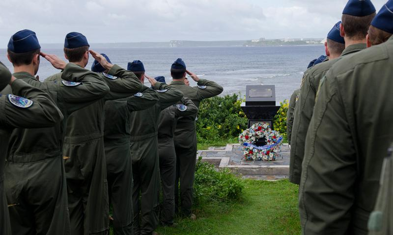 Aircrew from the 69th Expeditionary Bomb Squadron, currently deployed to Andersen from Minot Air Force Base, N.D., salute as taps is played during the annual Raider 21 memorial ceremony July 21, 2014, in Adelup, Guam. A monument was constructed at the Ricardo J. Bordallo Governor's Complex in 2009 to honor the aircrew lost off the coast of Guam during a mission in support of the 2008 Liberation Day parade. (U.S. Air Force photo by Senior Airman Katrina M. Brisbin)