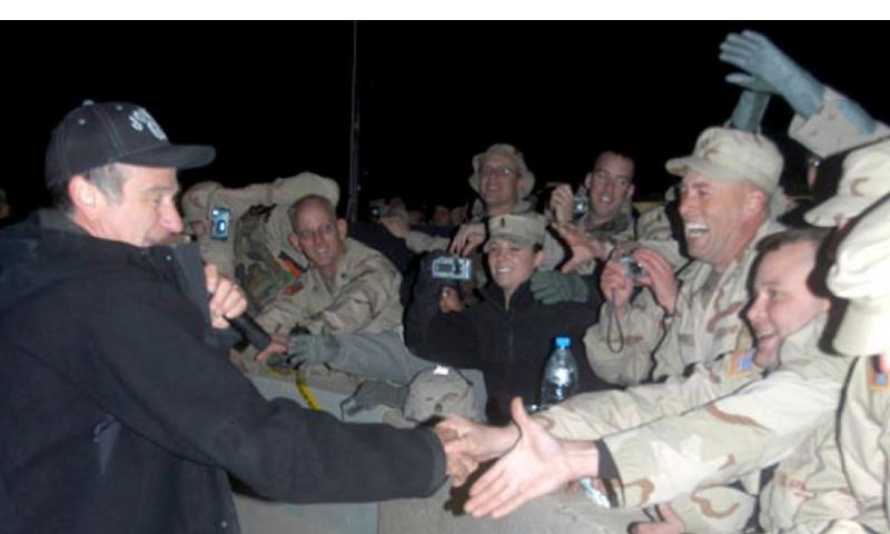 Robin Williams meets fans Tuesday at LSA Anaconda in Dec. 2004. RON JENSEN/STARS AND STRIPES