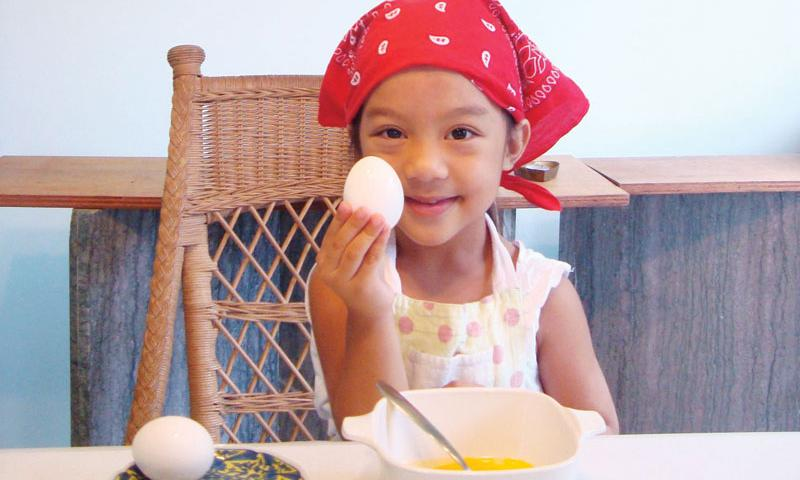 Rosario Peralta, 5, prepares her favorite butter eggs.  Photo courtesy of Jennifer Peralta