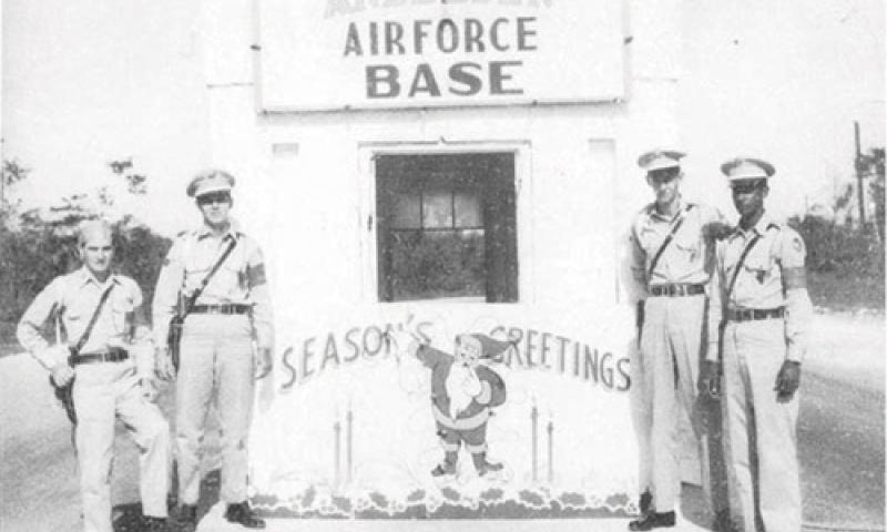 Long-Standing Tradition: Andersen Air Force Base's old front gate is decked out for the holidays circa 1949.  Photo courtesy of the 36th Wing History office