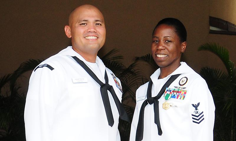 HONOLULU (April 12, 2013) Hospital Corpsman 1st Class Joseph Santos, left, U.S. Pacific Fleet Sea Sailor of the Year, and Mass Communication Specialist 1st Class Cassandra Thompson, U.S. Pacific Fleet Shore Sailor of the Year, pose for a photo after the announcement of the 2012 Pacific Fleet Sailors of the Year at the Hale Koa Hotel. (U.S. Navy photo by Chief Mass Communication Specialist Paula Ludwick)