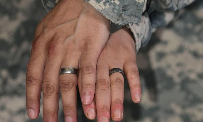 "U.S. Army Staff Sgt. Ashely Jacobs, left, and Sgt. 1st Class Rachel Underwood wed in February 2015, five years after the ""don't ask, don't tell"" act was revoked. South Korea has agreed to a U.S. decision to allow same-sex couples to receive the same legal protection and benefits as other military families under the status of forces agreement.     Kimberly Nagle/U.S. Air Force"