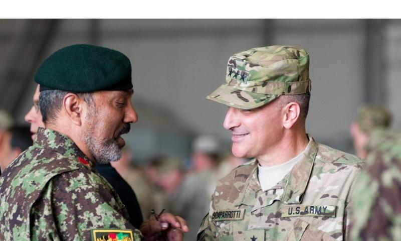 In this file photo from 2011, Lt. Gen. Curtis Scaparrotti speaks with an Afghan National Army officer after the ISAF Joint Command change of command ceremony in Kabul. Scaparrotti replaced Lt. Gen. David Rodriguez as IJC commander. BRANDON POMRENKE/COURTESY U.S. ARMY
