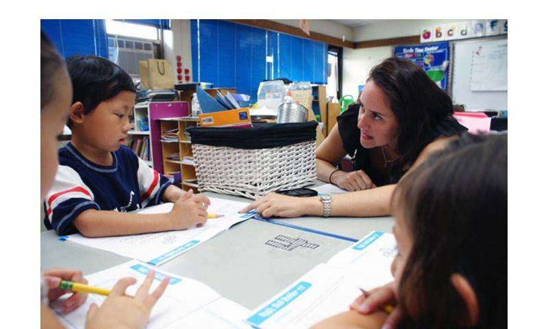 Calvin Yang listens as Cameron Gonzales, first grade/kindergarten teacher, gives instructions during the Summer Enrichment Program held by Seoul American elementary and middle schools in Seoul, July 2, 2010.   Alfredo Jimenez Jr./Stars and Stripes