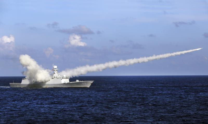 Chinese missile frigate Yuncheng launches an anti-ship missile during a military exercise in the waters near south China's Hainan Island and Paracel Islands on July 8, 2016.  Zha Chunming/Xinhua via AP