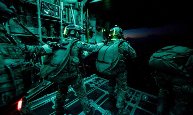 National Guardsmen with Company A, 2nd Battalion, 20th Special Forces Group (Airborne) prepare to exit a C-130 Hercules during a night training mission over Muscatatuck, Ind., Monday, Aug. 3, 2015.   Indiana National Guard, Joint Fo