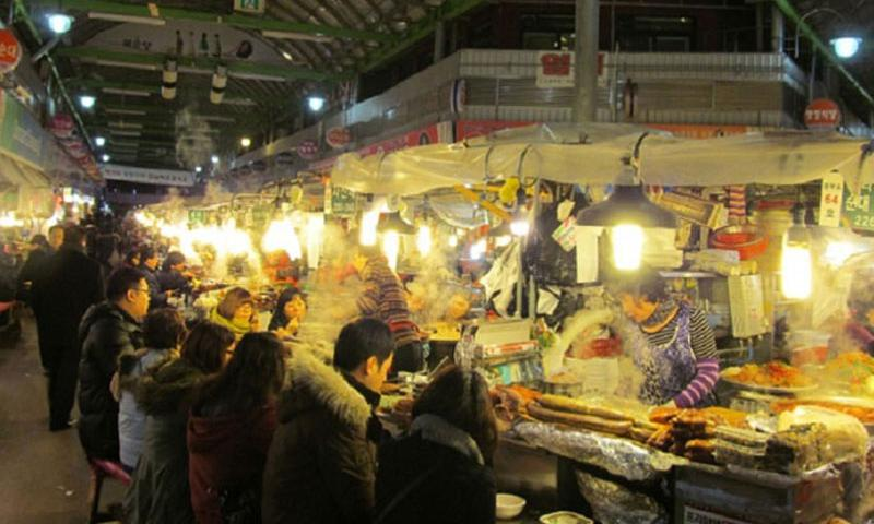 Food stalls bustle at Seoul's Gwangjang Market, where some of the best dishes in the Korean capital are offered at cheap prices to tourists and locals alike.