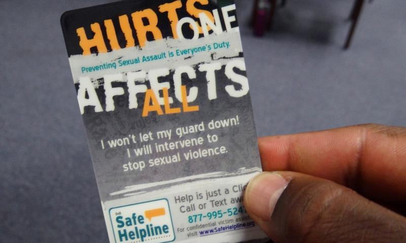 A staff member reviews a card given out during a Sexual Assault Awareness and Prevention Month training session conducted at the Center for Personal and Professional Development in Virginia Beach in this April 2013 photo.  Susan D. Henson/U.S. Navy