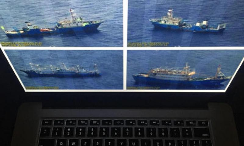 Photographs released by the Philippine government are displayed on a computer screen in Bangkok, Wednesday, Sept. 7, 2016. The Philippine government has released what it says are surveillance pictures of Chinese coast guard ships and barges at the disputed Scarborough Shoal in the South China Sea just hours before the Chinese premier attended a regional summit with Southeast Asian leaders. Charles Dharapak/AP