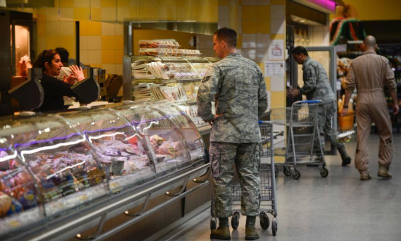 Customers shop at the commissary on Ramstein Air Base, Germany. A RAND study says raising prices in military commissaries to offset decreases in tax-payer dollars could be a bad idea.     Joshua L. DeMotts/Stars and Stripes