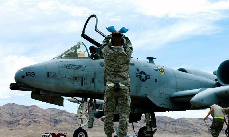 An Air Force crew chief watches as an A-10 Thunderbolt taxis into position after landing May 9, 2013, at Nellis Air Force Base, Nev. JOSHUA KLEINHOLZ/U.S. AIR FORCE