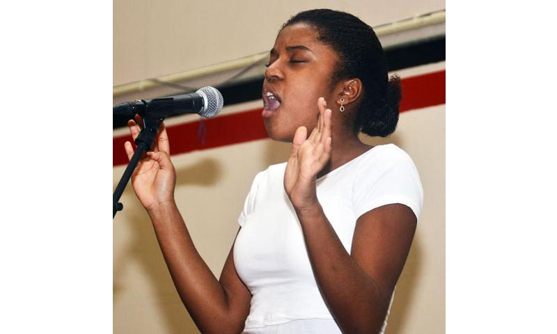 """Danielle Stephenson sings at the annual """"U got talent"""" show Oct. 23 at the Hot Spot, on Andersen Air Force Base, Guam, earning herself first place. The talent show is conducted Air Force-wide and video of each installation's First and Second place winners are then sent to the Air Force Entertainment Office for Air Force-level judging. U.S. Air Force photo by Airman 1st Class Mariah Haddenham"""