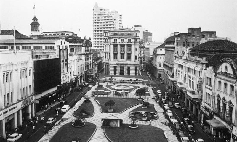 In this Jan. 5, 1968, file photo, the main street along Raffles Place which is now Singapore's financial district is seen. Singapore's 50th anniversary on Sunday, Aug. 9, 2015, commemorates its leap from a poor colonial port to a wealthy metropolis, but leaders are bracing themselves for an uncertain future as resentment continues to grow over political restrictions, an influx of foreigners and high cost of living.     AP Photo/File