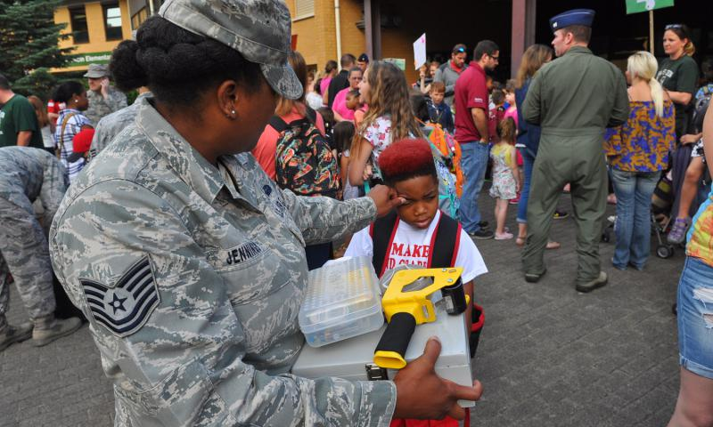Tech. Sgt. Twan Jennings tries to get her son, Kamarre, 7, to smile on the first day of school Monday, Aug. 29, 2016, at Ramstein Elementary School, Germany.
