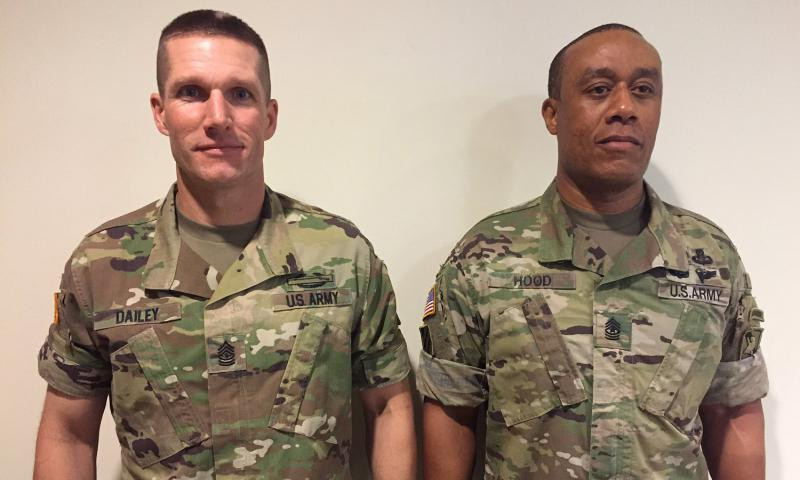 Sgt. Maj. of the Army Daniel Dailey, left, and Command Sgt. Maj. Stanley Hood show rolled-up sleeves - Dailey with camouflage rolled out, Hood with it in. Army chief of staff Gen. Mark Milley sent out a tweet asking soldiers which version they liked better. Milley has decided to allow soldiers to roll their sleeves. 	 U.S. Army