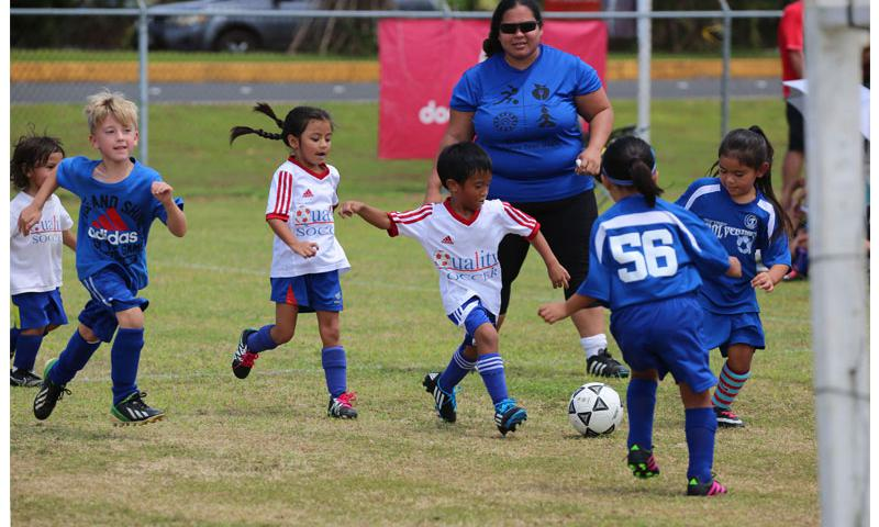 Quality Distributors and Guam Shipyard Wolverines play in an opening week U6 division match of the Triple J Auto Group Robbie Webber Youth Soccer League Saturday at the Guam Football Association National Training Center.