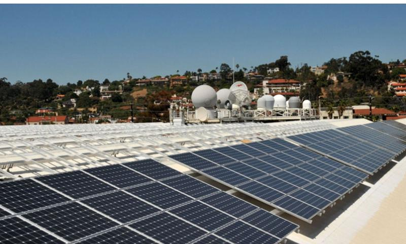 In this file photo from Aug. 3, 2011, solar panels are seen on the roof of Space and Naval Warfare Systems Command Headquarters Old Town Complex in San Diego.   Rick Naystatt/U.S. Navy