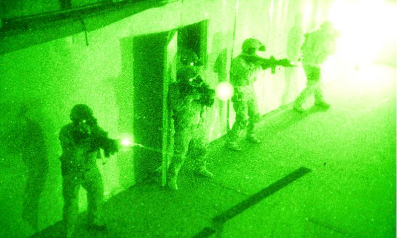 A group of U.S. Navy SEALs clear a room during a no-light live-fire drill near San Diego on Dec. 4, 2015.     Daniel Stevenson/U.S. Navy