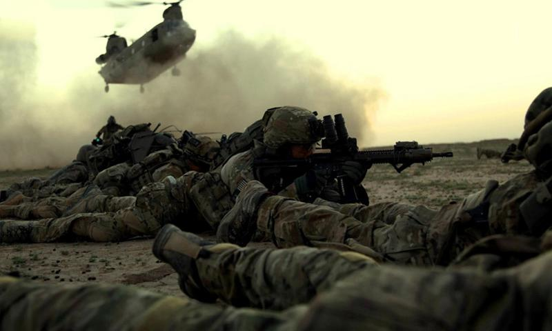 Rangers from 1st Battalion, 75th Ranger Regiment, as part of a combined Afghan and coalition security force operating in Ghazni province, Afghanistan, await a CH-47 for extraction. Pedro Amador/Courtesy of the U.S. Army