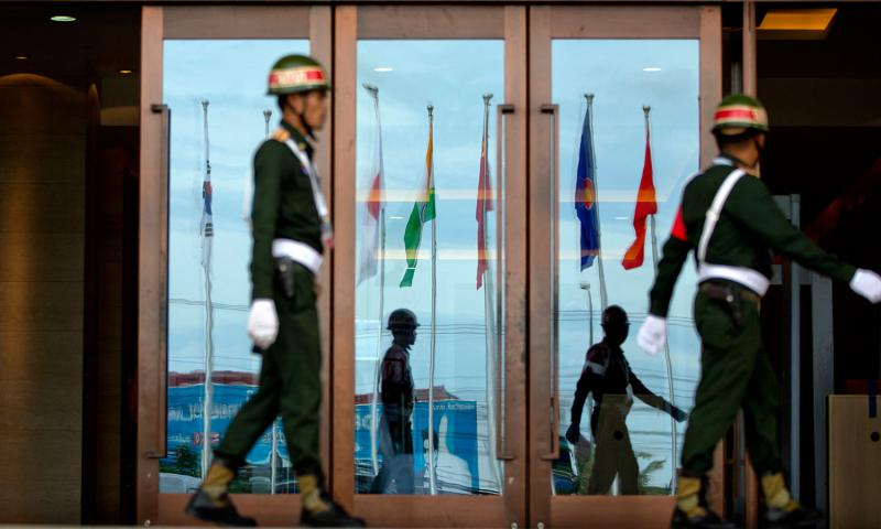 Flags of the member countries of the Association of Southeast Asian Nations (ASEAN) and their key dialogue partner nations are reflected on the glass doors of a conference hall, the venue for ASEAN and related meetings in Vientiane, Laos, Sunday, Sep 4, 2016. Gemunu Amarasinghe/Associated Press