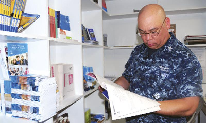 Mass Communication Specialist 2nd Class (AW) Ricardo Danan, of USS Frank Cable, looks at educational brochures in the Navy College Office on U. S. Naval Base Guam (NBG) Sept. 11. U.S. Navy photo by Mass Communication Specialist 2nd Class Jeremy Starr/Released