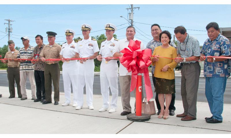 HAGATNA, Guam (July 9, 2014) – Representatives from the military and local communities cut the ceremonial ribbon for the Route 1/8 Intersection and Agana Bridge Reconstruction Projects in Hagatna, Guam July 9. The $16.4 million project, which was 100 percent federally funded, was the result of a 2008 study of Guam's specific routes that would be utilized during the Marine Corps relocation from Okinawa to Guam. (U.S. Navy photo by JoAnna Delfin)