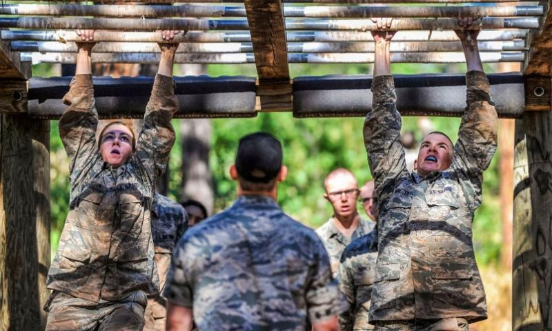 "Basic cadets navigate the monkey bars on the obstacle course in the U.S. Air Force Academy's Jacks Valley during the field portion of their Basis Cadet Training July 22, 2015, in Colorado Springs, Colo. ""Second Beast"" is the second half of Basic Cadet training which began with inprocessing June 25, 2015.    Liz Copan/U.S. Air Force Photo"