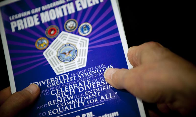 A pamphlet is held during a Pentagon Lesbian, Gay, Bisexual and Transgender Pride Month celebration event on June 26, 2012. 	 Chad J. McNeeley/U.S. Navy