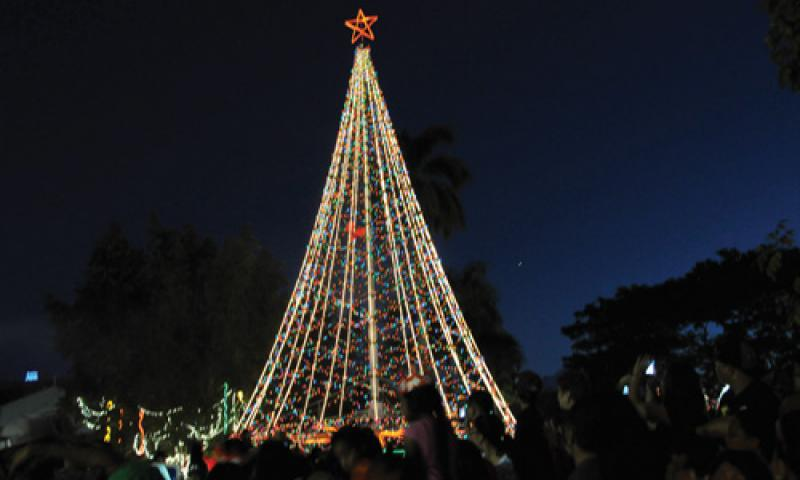 The 30-foot Christmas tree is lit during the Guam Chamber of Commerce's 20th Annual Christmas Festival at Skinner Plaza in Hagatna Nov. 24. Local and military community members attended the event which welcomed the start of Christmas season. U.S. Navy photo by JoAnna Delfi