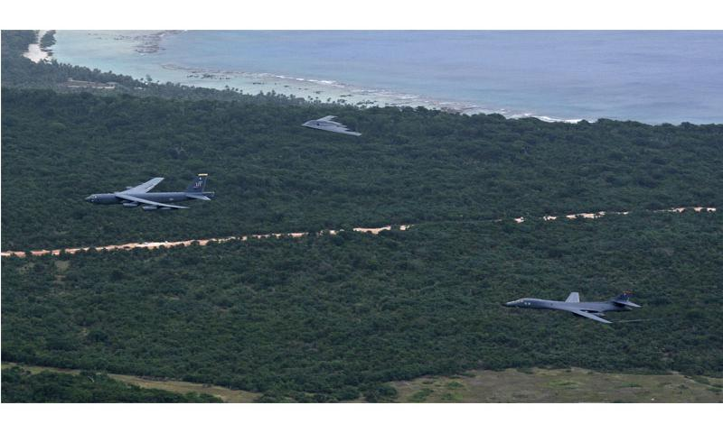 A U.S. Air Force B-52 Stratofortress, B-1 Lancer and B-2 Spirit fly over Guam after launching from Andersen Air Force Base, Guam, for an integrated bomber operation Aug.17, 2016. This mission marks the first time in history that all three of Air Force Global Strike Command's strategic bomber aircraft are simultaneously conducting integrated operations in the U.S. Pacific Command area of operations.  U.S. Air Force photo by Senior Airman Joshua Smoot