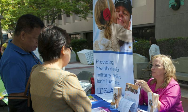 A Tricare representative gives information about the program to guests at Naval Medical Center San Diego in this file photo from 2013. CYD ST. JOHN/U.S. NAVY