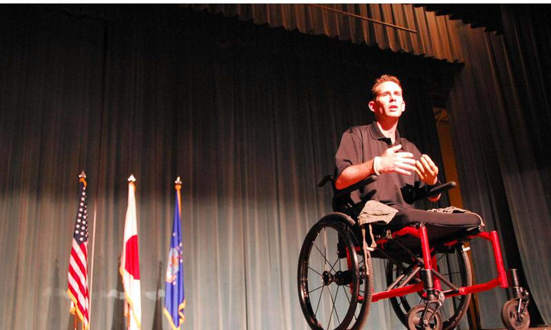 Bryan Anderson, an Iraq war veteran and triple amputee, speaks June 18 at the Keystone Theater at Kadena Air Base on Okinawa. Anderson, who won a regional Emmy for his PBS series, also appeared in ''The Wrestler,'' with Mickey Rourke. Travis Tritten/Stars and Stripes