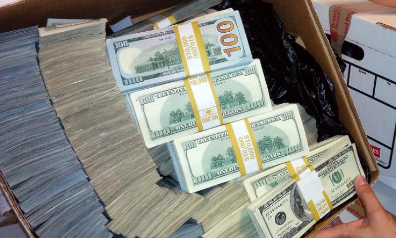 A Homeland Security agent shows a box filled with bundles of $100 bills after a bust in a suspected money-laundering scheme. Donald Trump has made references to an investigation that indicated U.S. servicemembers were involved in the theft of billions of dollars of U.S. currency in Iraq. U.S. Immigration and Customs Enf