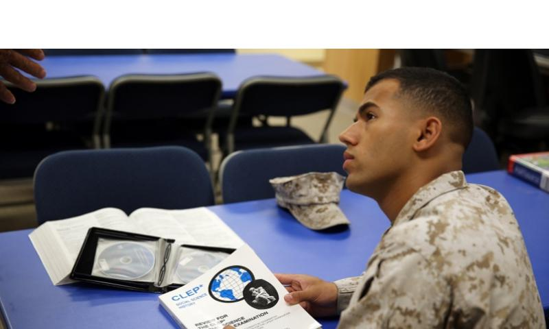 Lance Corporal Samuel Ribeiro, an adjutant clerk on Marine Corps Logistics Base Barstow, Calif., receives information about the College Level Examination Program at the base library on Sept. 9, 2013. U.S. MARINES