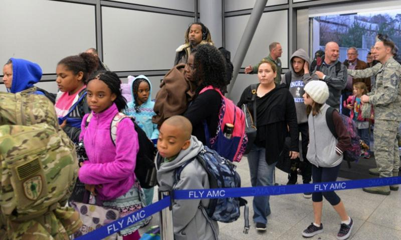 Dependents from Incirlik Air Base, Turkey, arriving at Ramstein Air Base, Germany, stand in line at passport control, on Thursday, March 31, 2016. They were on the fourth flight out of Incirlik, with one more due late Thursday night and one Friday.     Michael Abrams/Stars and Stripes